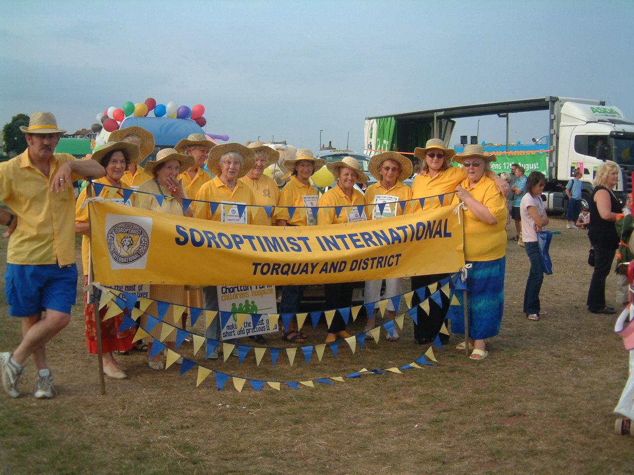 members of Torquay club taking part as walking group in Carnival