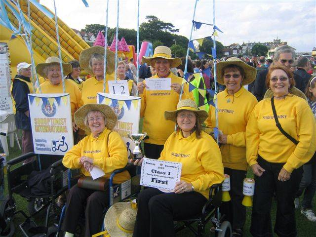 Past President Jane with group of members collecting for Shopmobility