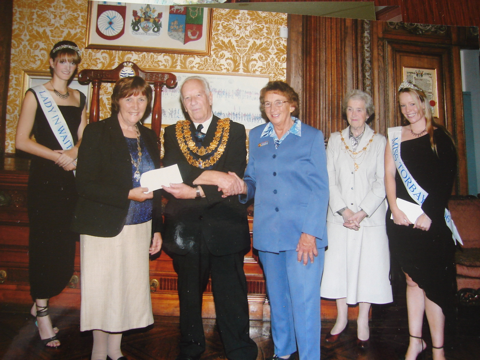 Mayor of Torbay presenting cheque for winning entry in local carnival